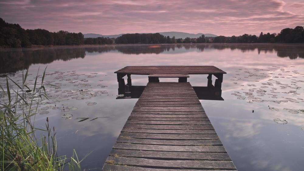 Purple dawn from a wooden dock wallpaper