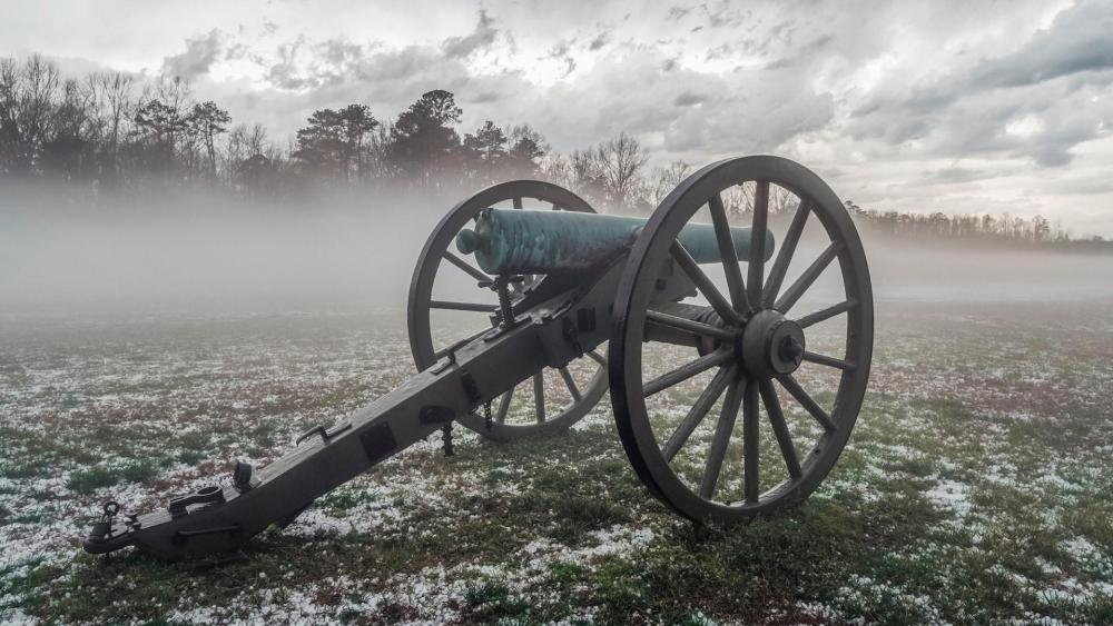Old cannon in a foggy field wallpaper