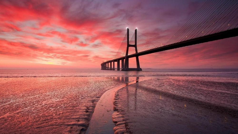 Vasco da Gama Bridge at sunset wallpaper
