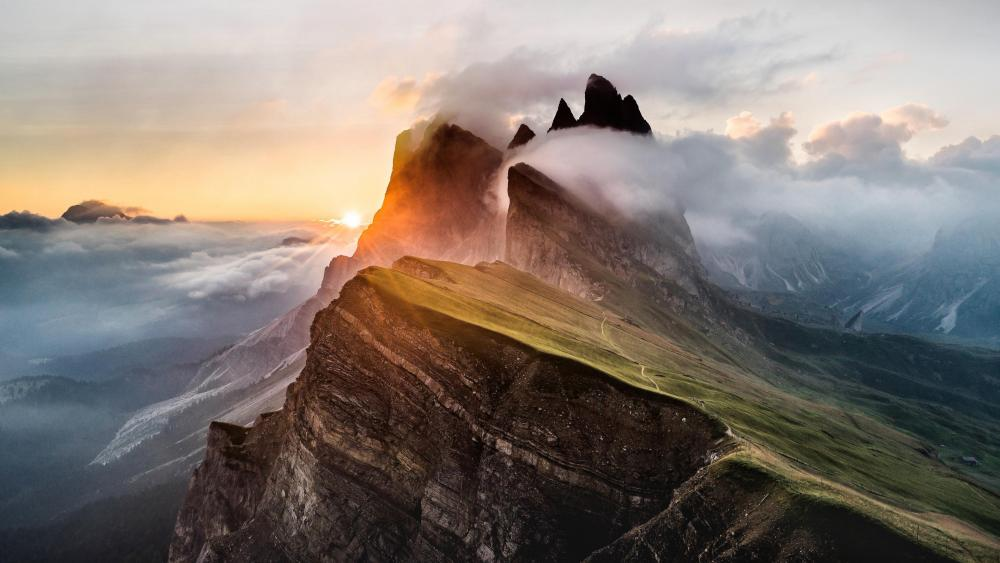 Sunrise with morning fog in Odle Mountains wallpaper