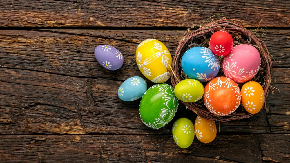 Colorful Easter eggs in a basket wallpaper