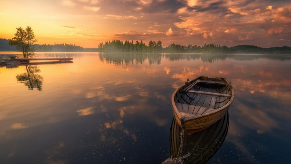 Boat in a silent lake wallpaper