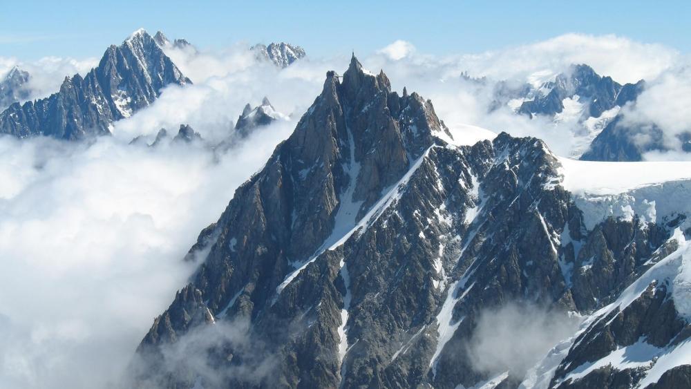Aiguille du Midi in the clouds wallpaper