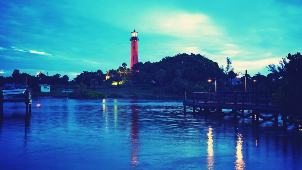 Red lighthouse next to the water wallpaper