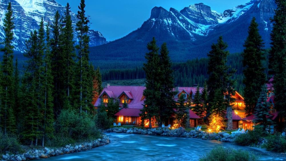 Cozy village between high mountains wallpaper