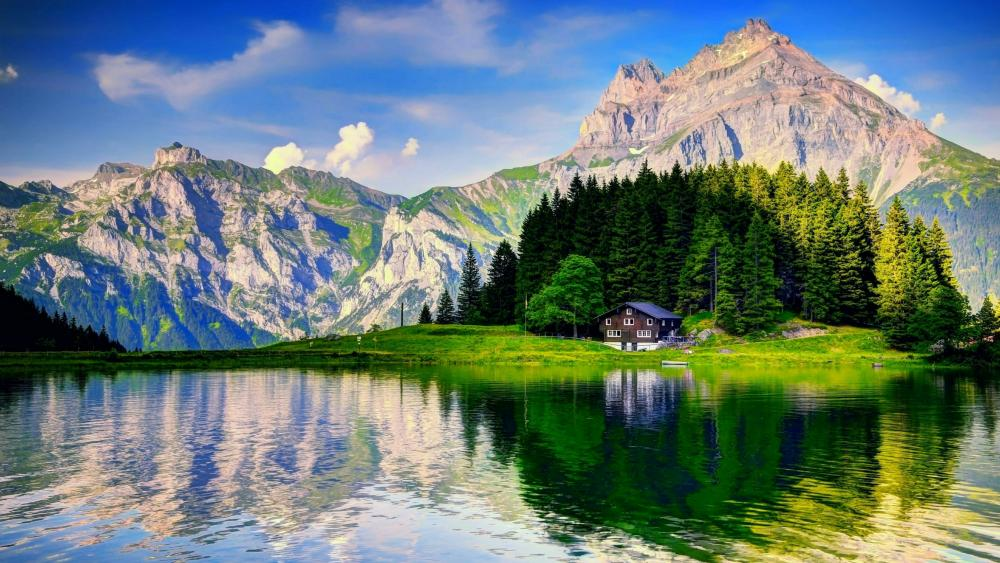 Swiss Alps with a little cottage wallpaper