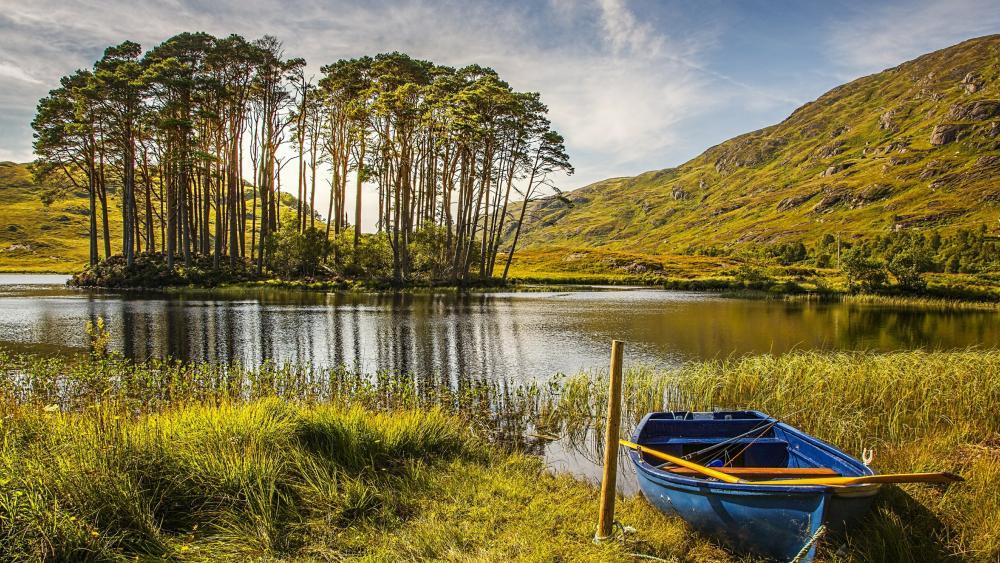 Blue boat at lakeside wallpaper