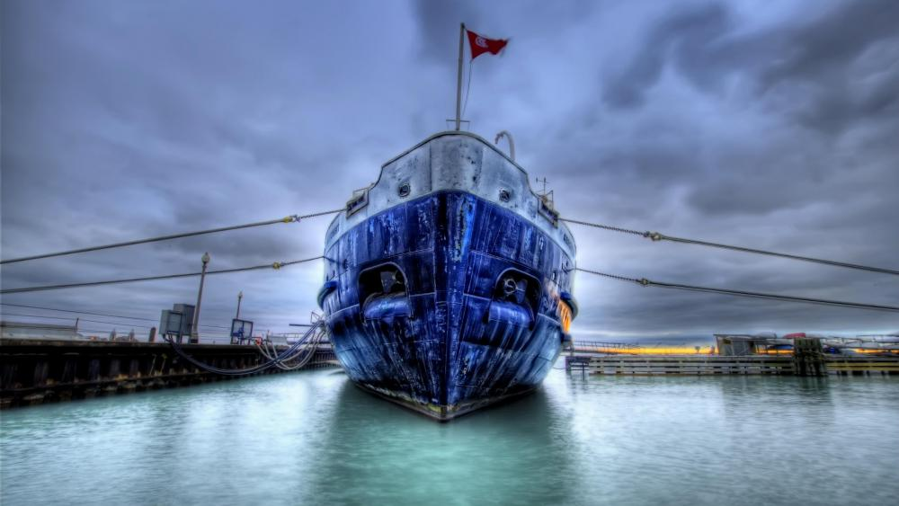 Blue ship in the harbour wallpaper