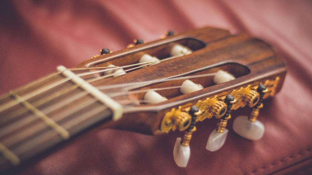 guitar fretboard strings in gold wallpaper