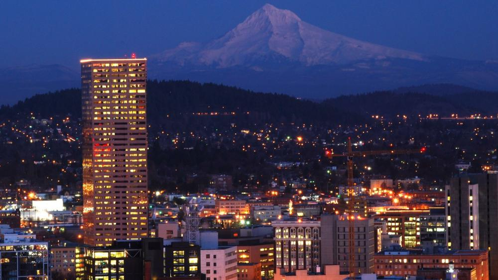 Bancorp Tower and Mount Hood at night wallpaper