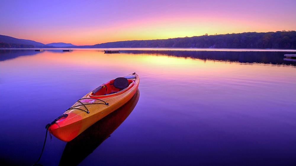 Kayaking on lake at sunrise wallpaper