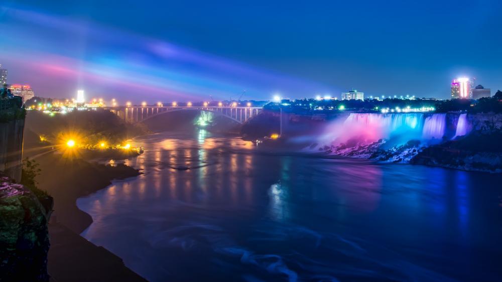 Niagara Falls and the Rainbow Bridge at night wallpaper