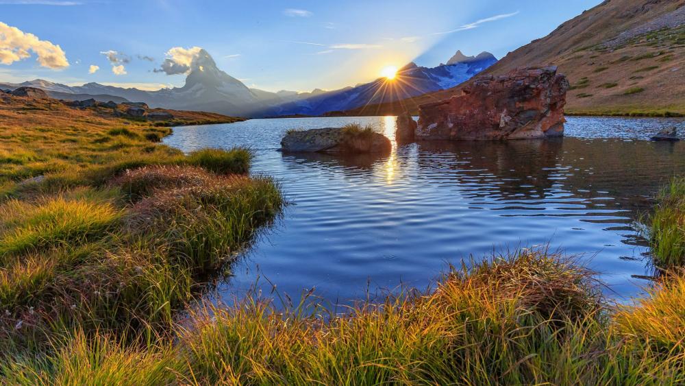 Sunset above mountain lake wallpaper