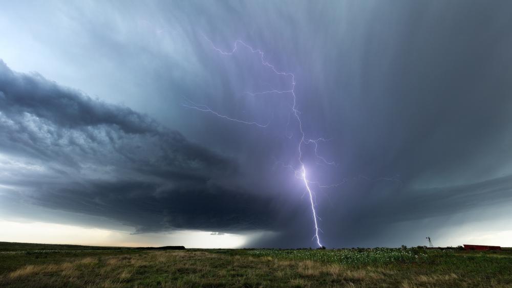 Lightning strike in field wallpaper