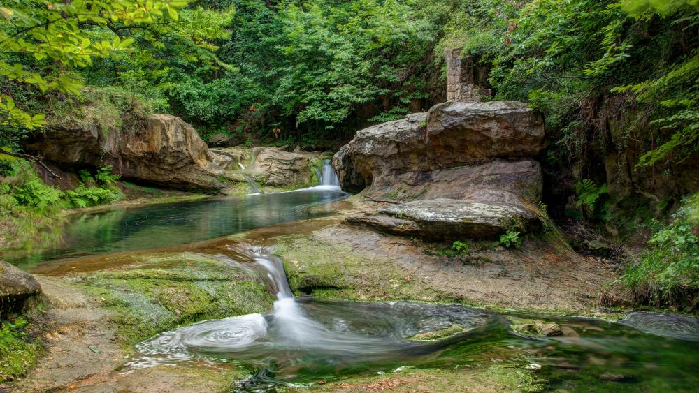 Fabulous waterfall in the green forest wallpaper