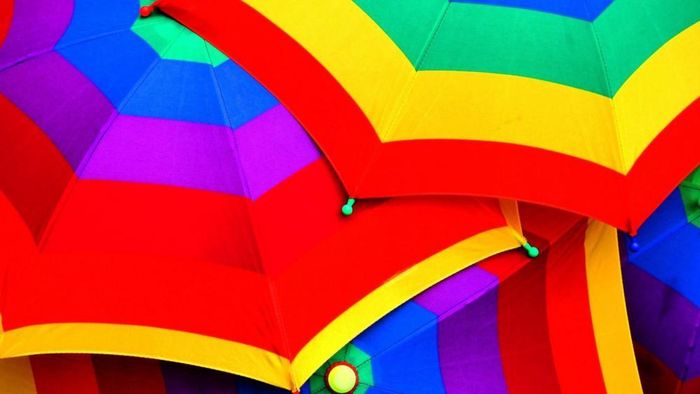 Rainbow colored umbrellas wallpaper
