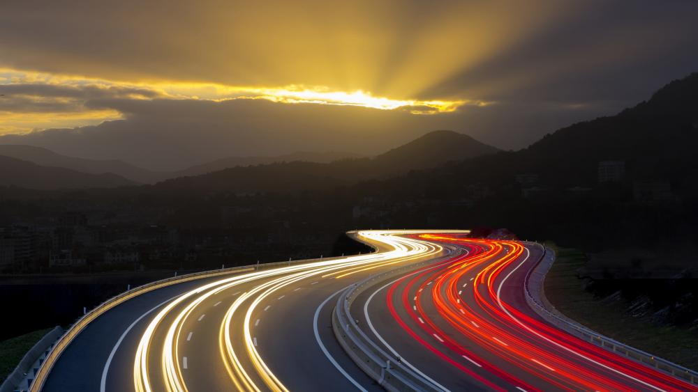 Light trails on highway - long exposure photography wallpaper
