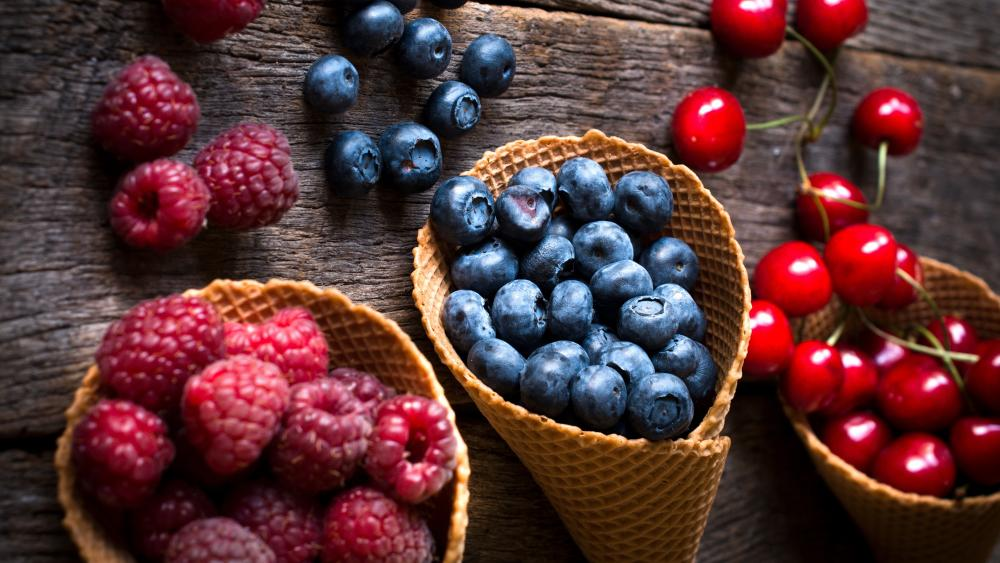 Raspberry, blueberry and cherry in cones wallpaper