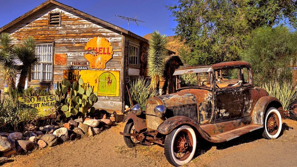 Rusty vintage car in front of Hackberry General Store wallpaper