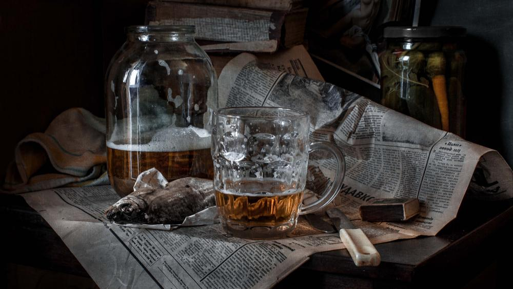 Fish and beer on a newspaper wallpaper