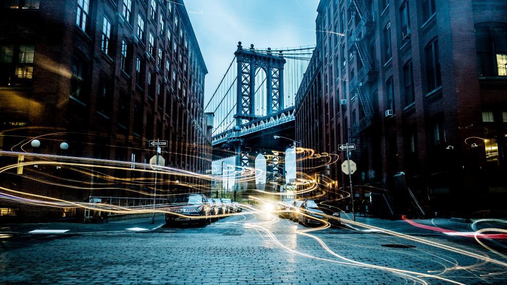 Manhattan Bridge with light trails wallpaper