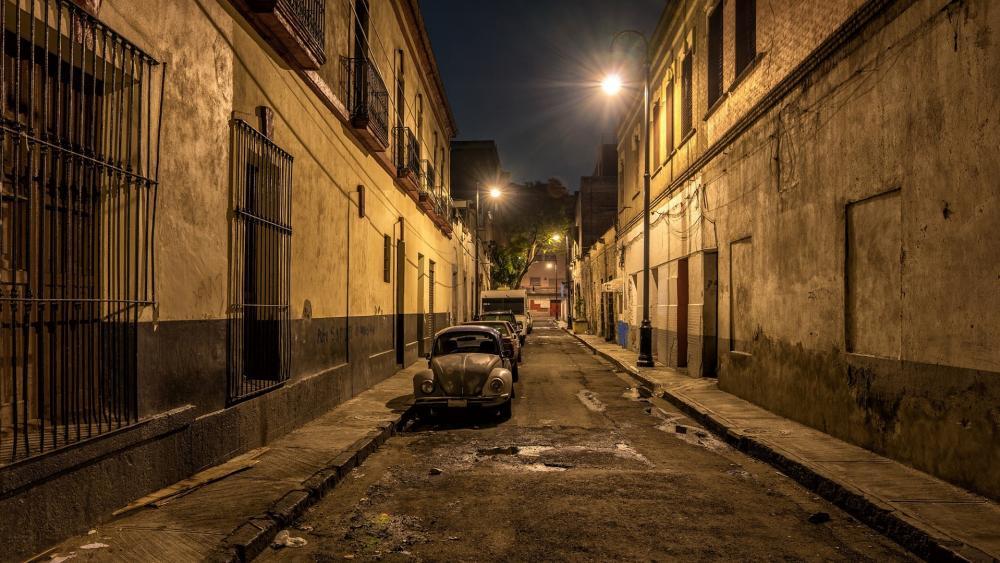 Old Volkswagen Beetle on the night street wallpaper