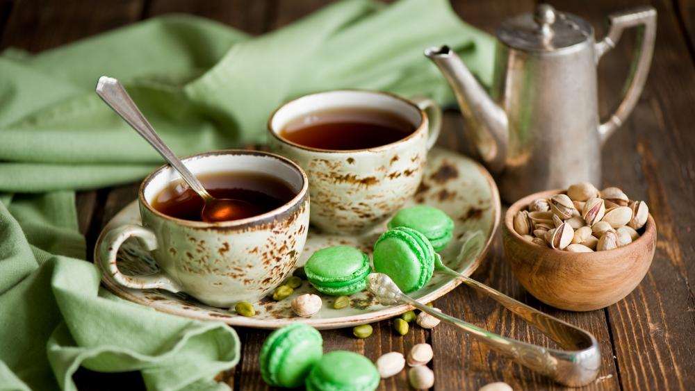 Tea with green macaroons wallpaper