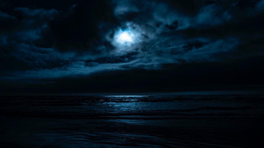 Moonlight between the clouds wallpaper