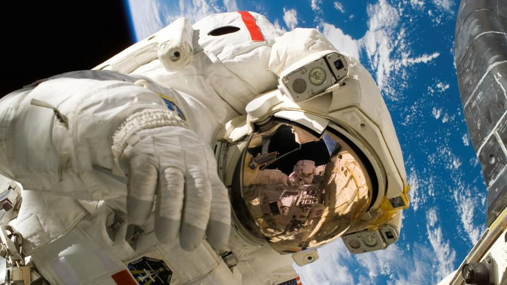 Astronaut on spacewalk wallpaper