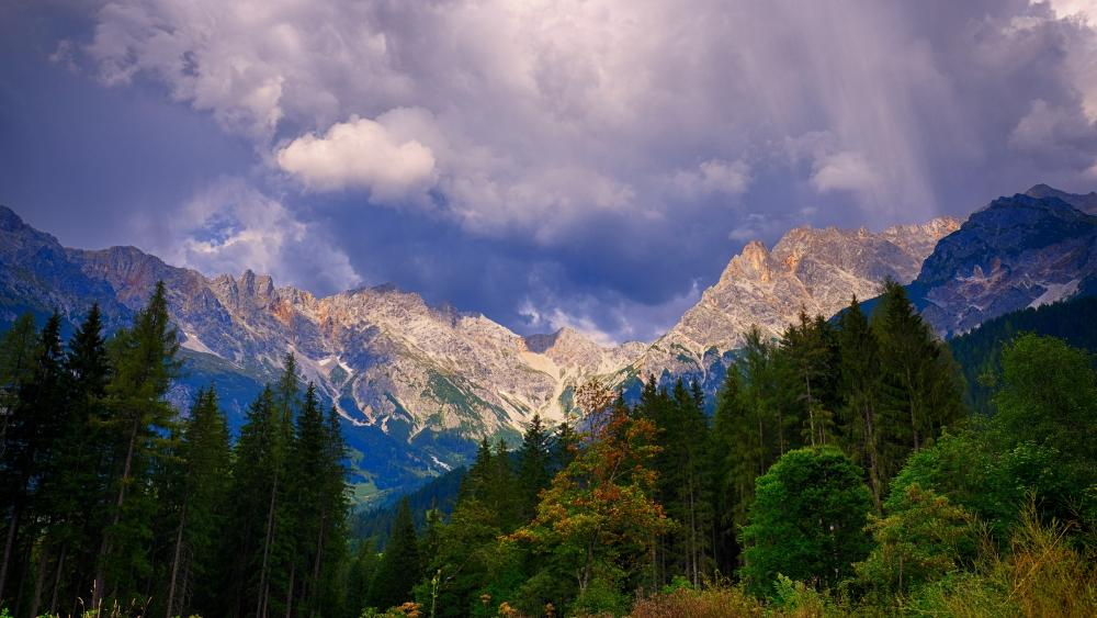 Mountain peaks under the clouds wallpaper