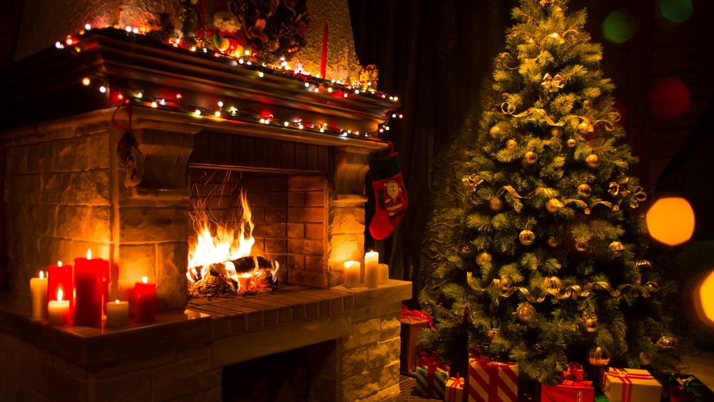 Candle light in the fireplace at Christmas wallpaper