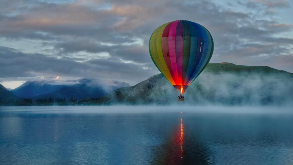Hot air ballooning above the lake wallpaper