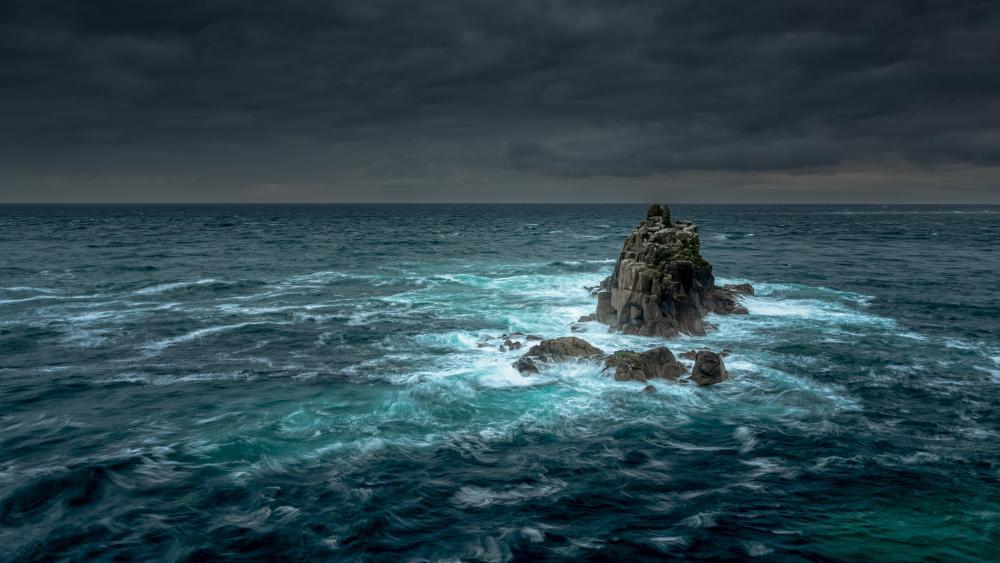 Rock islet in the ocean wallpaper