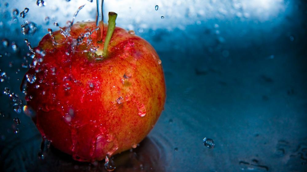 Waterdrops on an apple wallpaper