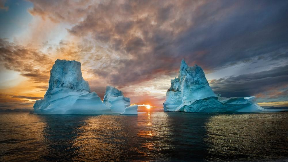 Icebergs in the midnight sun wallpaper