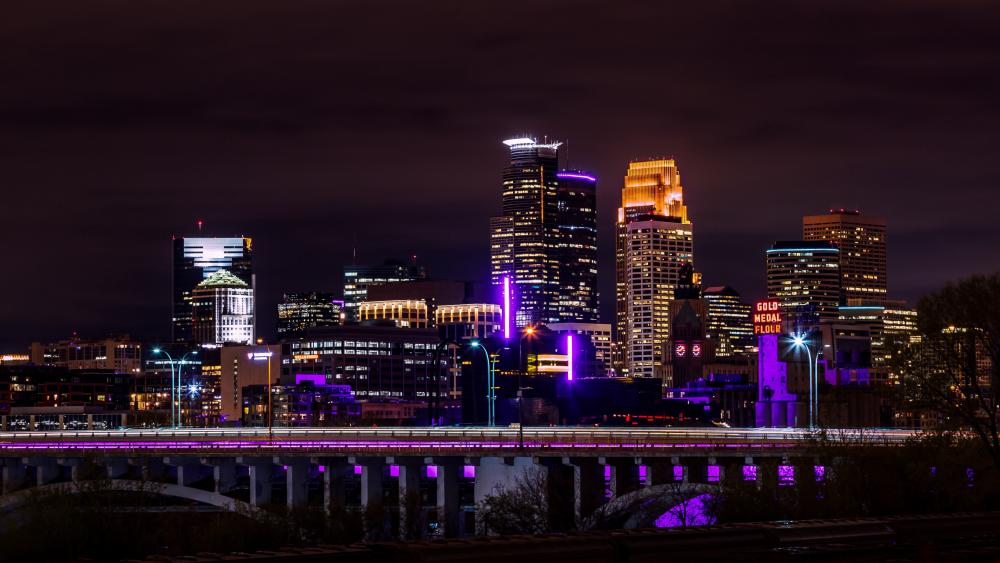 Minneapolis skyline lit up in purple wallpaper