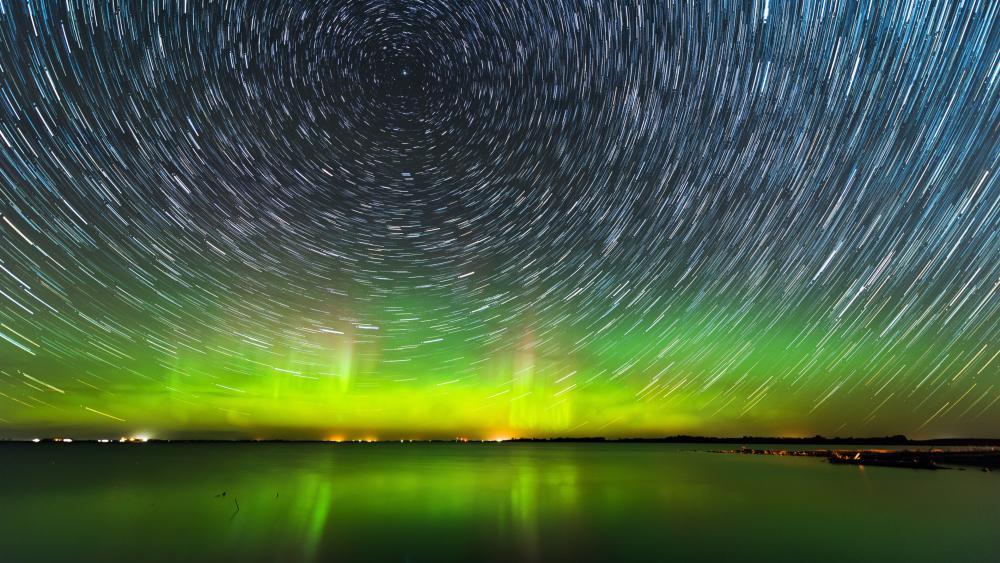 Star trails and Aurora Borealis wallpaper