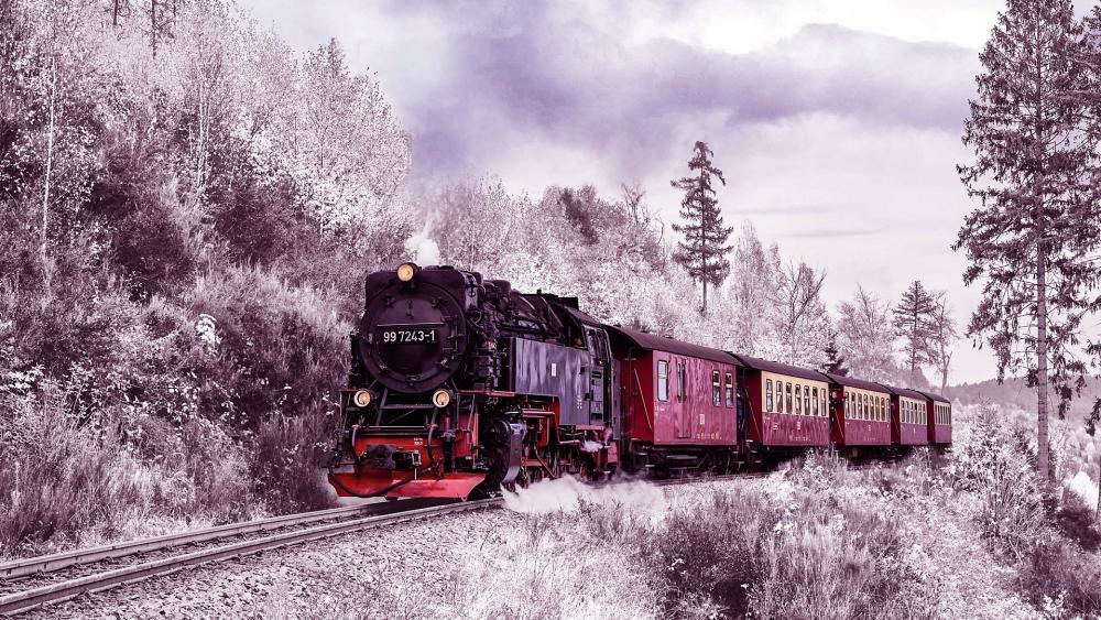 Steam train in winter landscape wallpaper