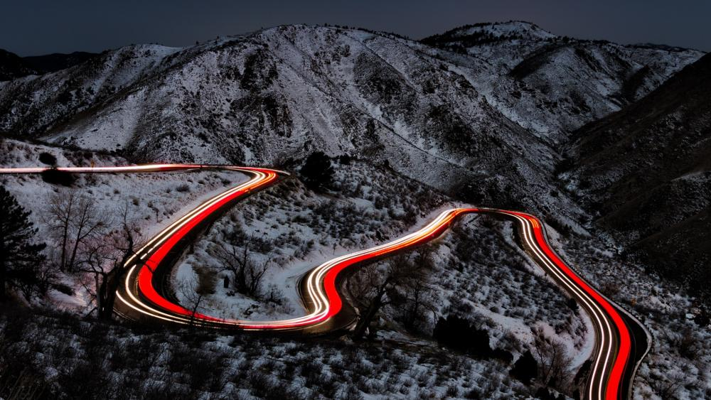 Mountain pass light trails wallpaper