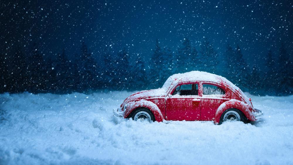 Volkswagen Beetle in the snowfall wallpaper