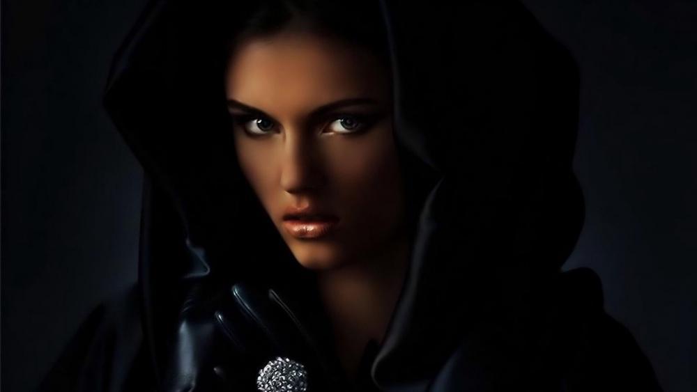 Girl in hooded black cloak wallpaper