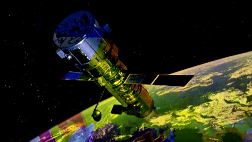 Satalite in Colorful Atmosphere wallpaper