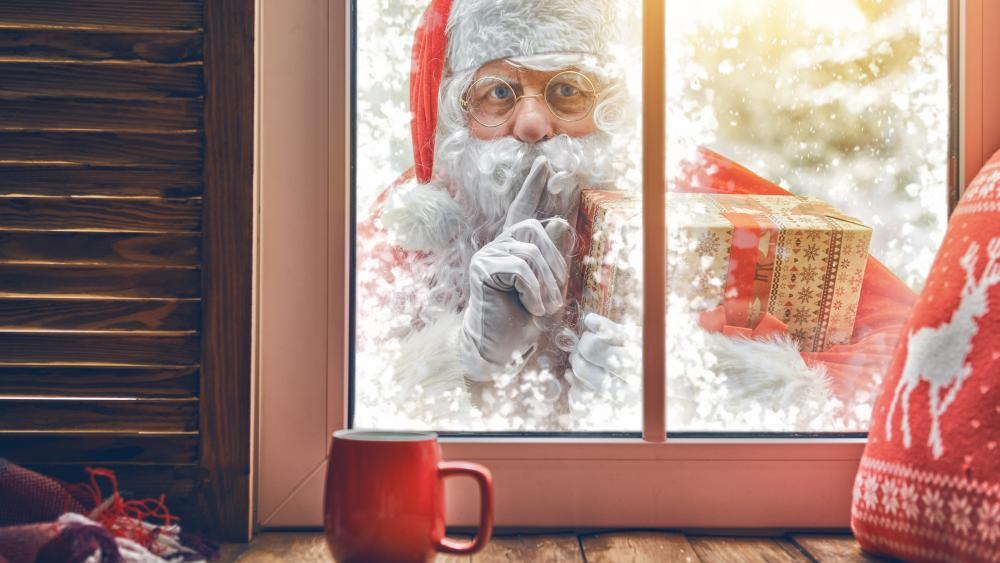 Santa Claus in front of the window wallpaper