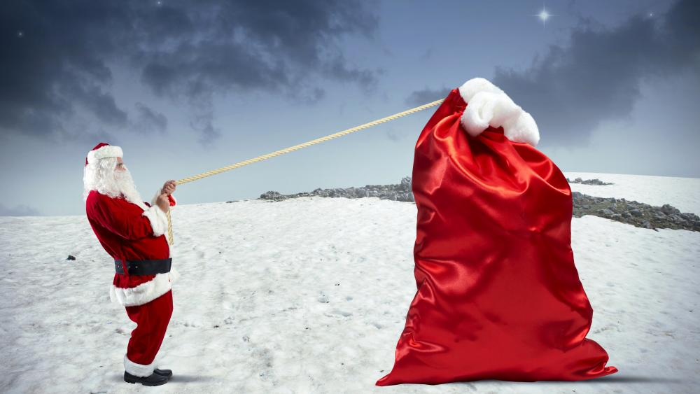 Santa Claus with a huge red sack wallpaper
