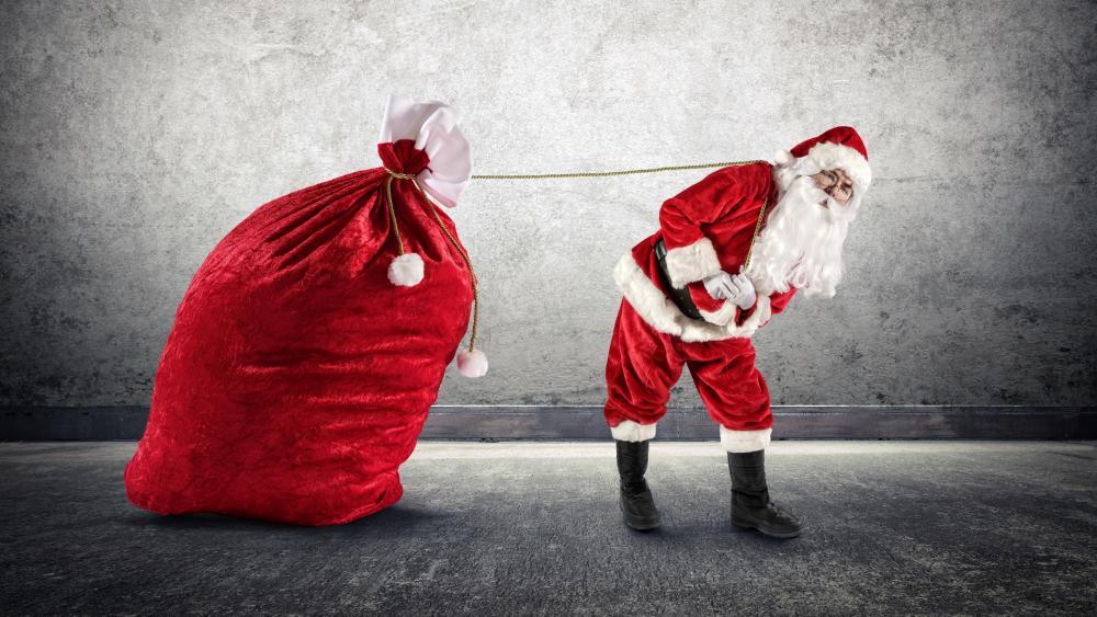 Santa Claus pulls his red sack wallpaper