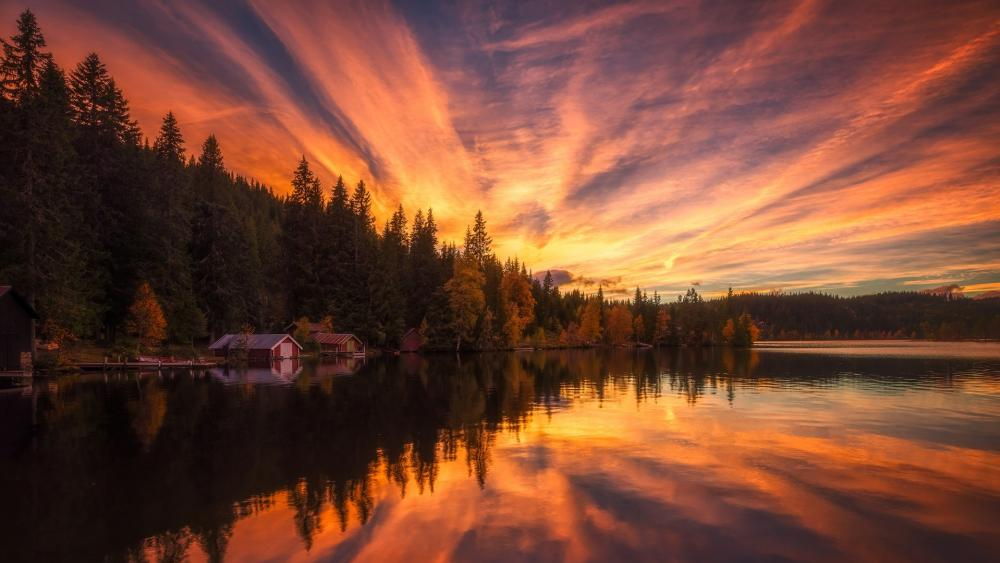 Red boathouses in the sunset wallpaper