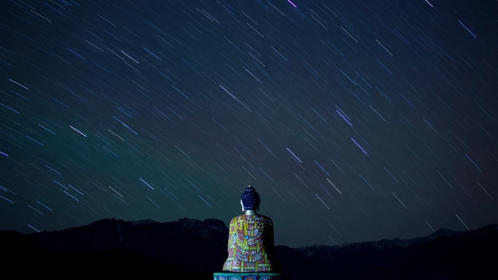 Star trails over Buddha wallpaper