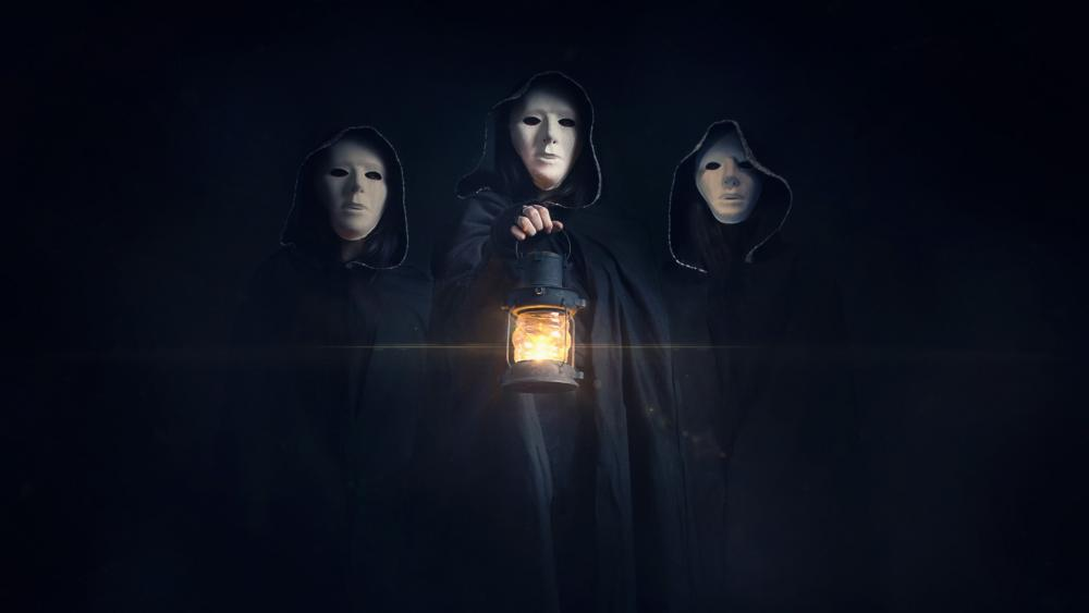 Masked hooded people with lantern wallpaper