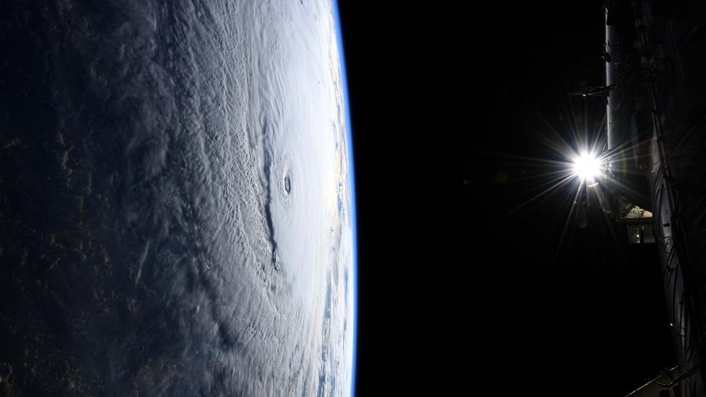 Space Station Flight Over Hurricane Lane wallpaper