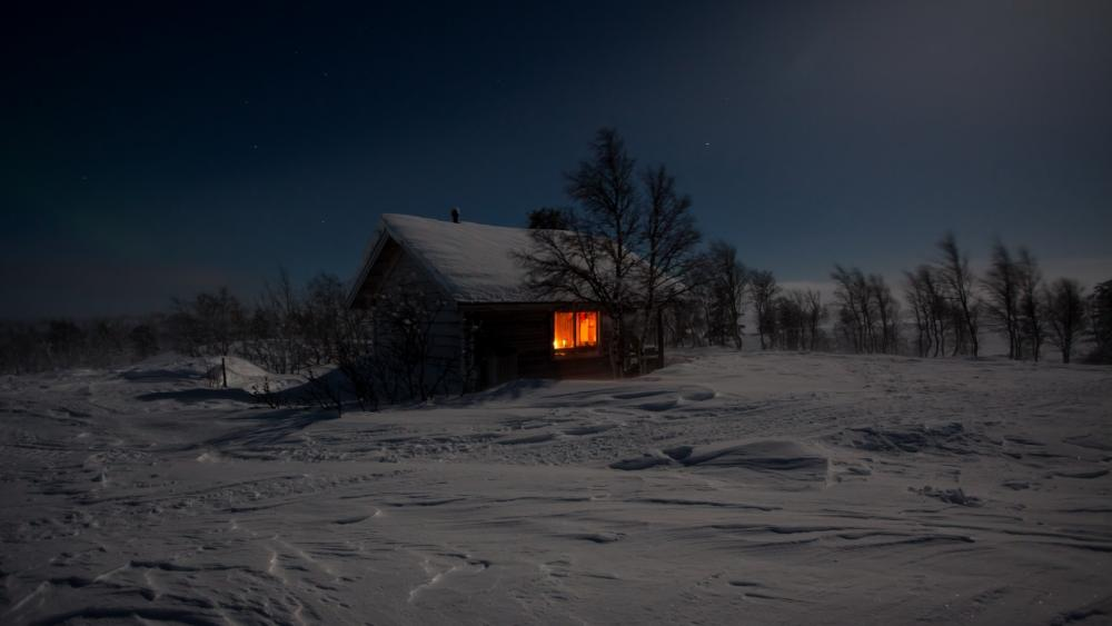 Solitary snowy house at winter night wallpaper